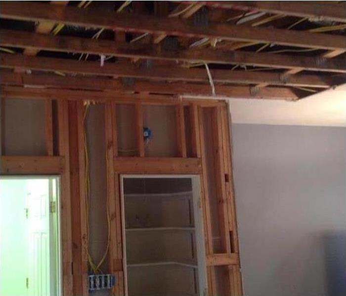 Ceiling and wall torn out from water damage
