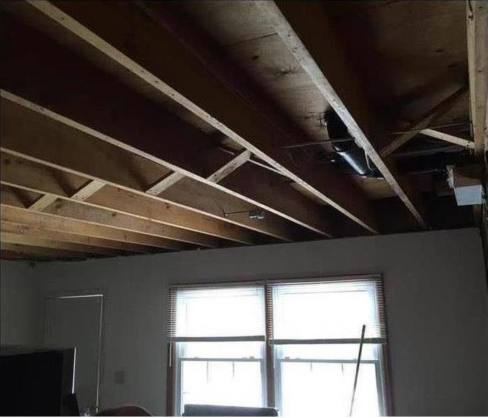 Ceiling repaired after a storm tore it open