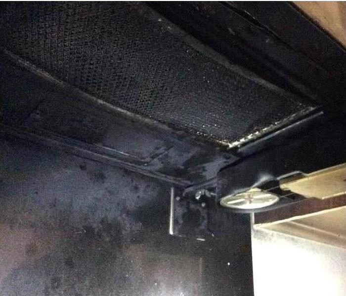 Microwave caused fire damage